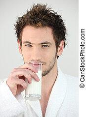 Man drinking a glass of milk