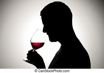 man drinking a red  wine