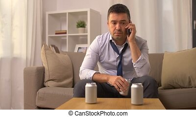 man drinking alcohol and calling on smartphone - alcoholism,...