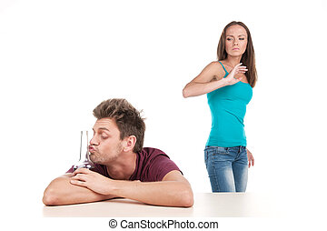 Man drinking alcohol and woman leaving him. Photo of family conflict with alcoholic husband on white background