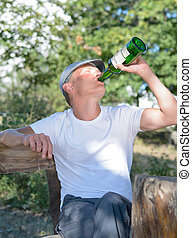 Man drinking alcohol from a bottle
