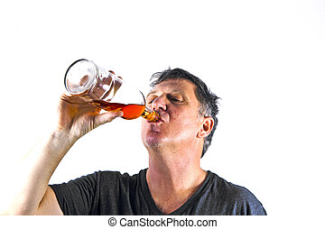 man drinking alcohol out of a bottle
