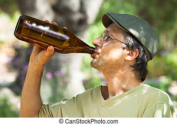 Man drinking beer from bottle