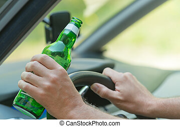 Man drinking beer in a car