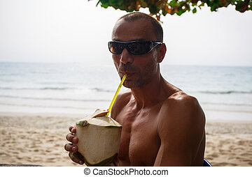 Man drinking coconut