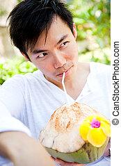 Man Drinking Coconut