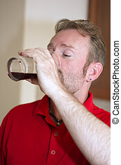 Man Drinking Fruit Juice