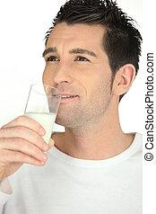 Man drinking glass of milk