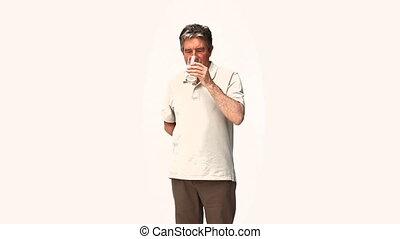 Man drinking medicine