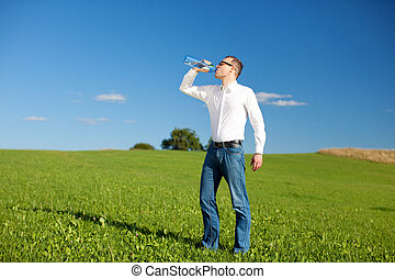 Man drinking mineral water