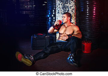 man drinking protein cocktail from shaker