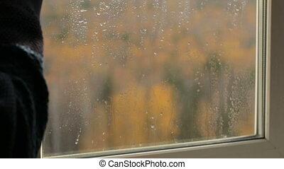 Man drinking tea at the window