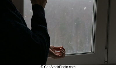 Man drinking tea near the window