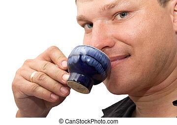 man drinking tea on a white background