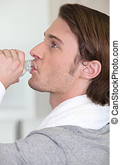 Man drinking water after a workout
