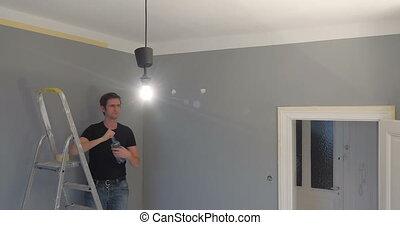 man drinking water on ladder