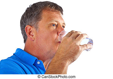 man drinking water out of a glass