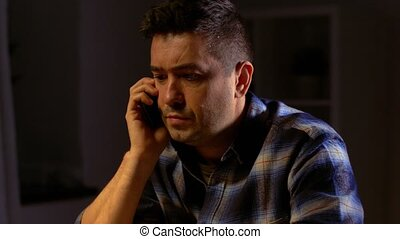 man drinking whiskey and calling on smartphone - alcoholism,...