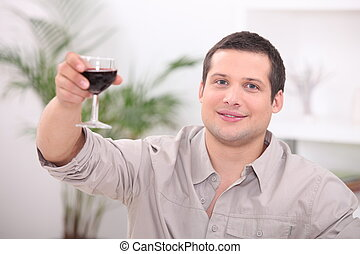 Man drinking wine alone