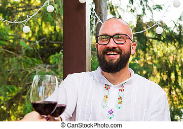 Man drinking wine on a date