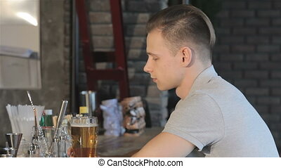 Man drinks beer at the bar
