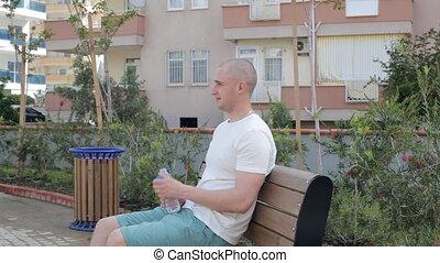 Man drinks water outdoor