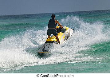 man drive on the jetski - Man on Wave Runner turns fast on...