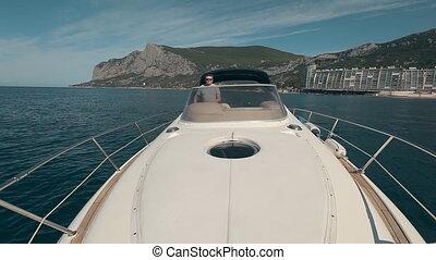 Man drives the yacht