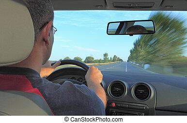 Man driving a car - Interior car image of a man driving.Main...