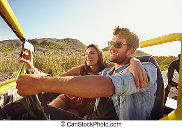 Couple having fun on road trip