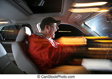 Man driving car at night, speeding fast.