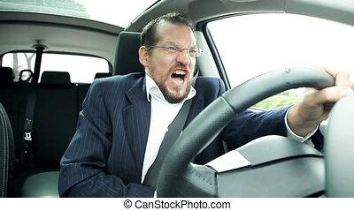 Man driving car feeling sick