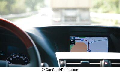 Man Driving Car With Integrated GPS Navigation