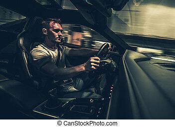 Man Driving Exotic Car At Night.