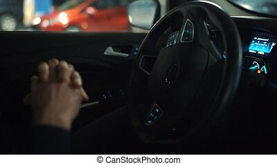 Man driving in innovative automated car using self-parking...