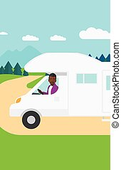 Man driving motor home. - An african-american man driving a...