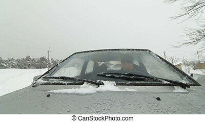 man driving on  snowy road