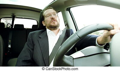 Man driving smelling stinky air