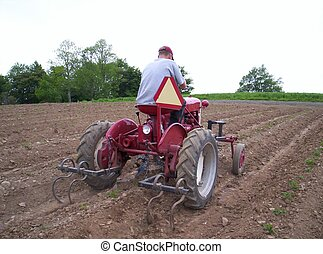 man driving tractor - man driving farm tractor he is...