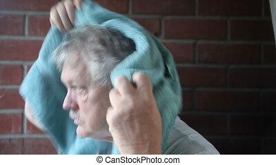 man drying hair