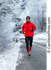 Man during a workout on icy road in winter