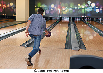 Man during the throwing bowling ball