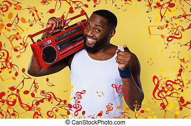 Man ears the music with an old stereo and dances. emotional and energetic expression. yellow background