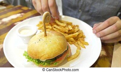 man eating a hamburger. close-up. cutlet sandwich. 4k.