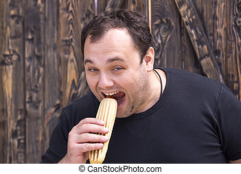 man eating a hot dog