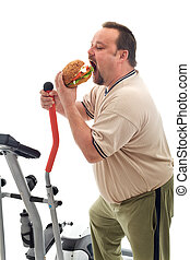 Man eating a large hamburger instead of working out