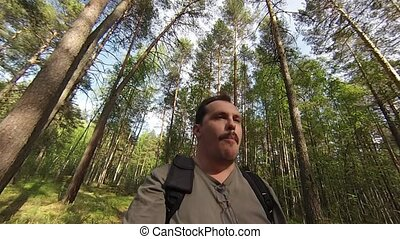 Man eating carrot in forest