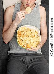 Man eating chips