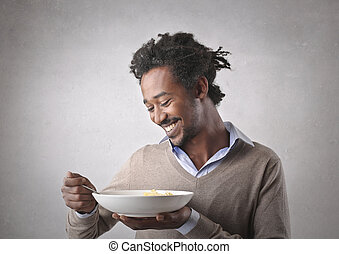 Man eating from plate