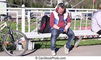 Man eating ice cream on a bench